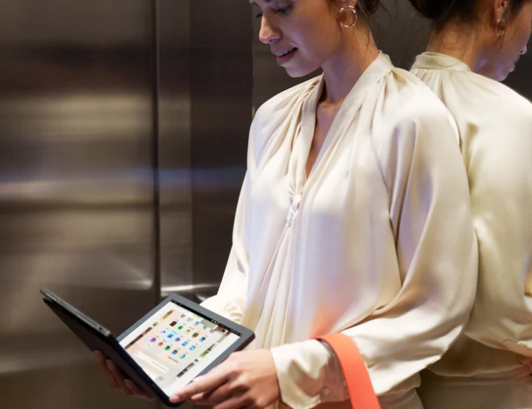 ThinkPad X1 Fold woman in elevator on mobile